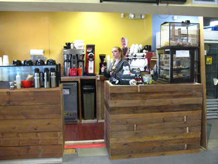 Barista Kate Taussig gives a thumbs-up for the new Coffee Bar set-up.