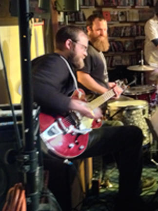 Chris Cretella (guitar) and Michael Paolucci (drums).