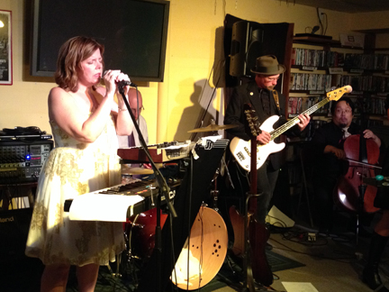 Julie Beman, left, and Eric Bloomquist, right, on bass when The Dress-Ups played Best Video Performance Space in 2014.